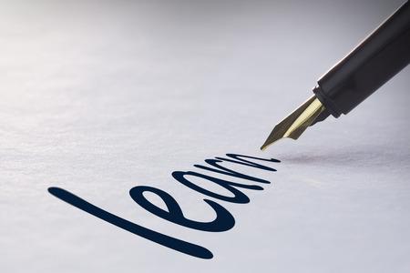 university fountain: Fountain pen writing the word learn