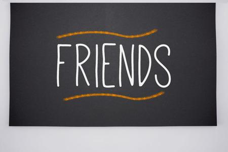 The word friends written on big blackboard Stock Photo