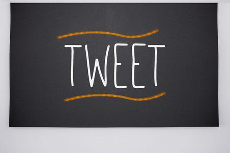 tweet: The word tweet written on big blackboard