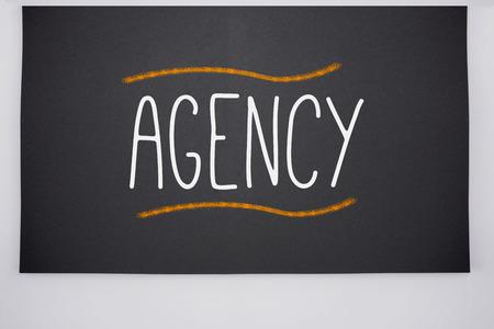 The word agency written on big blackboard