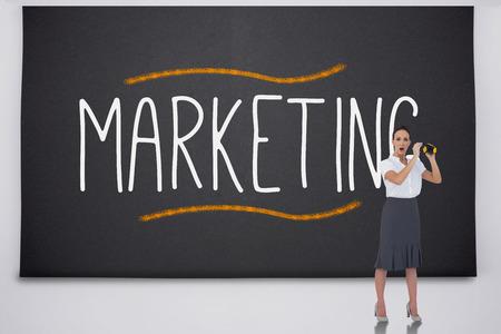 Shocked businesswoman with binoculars against the word marketing photo