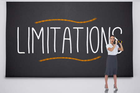 limitations: Shocked businesswoman with binoculars against the word limitations
