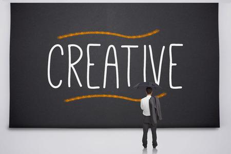 Businessman reading the word creative photo