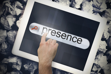 online internet presence: Hand touching the word presence on search bar on tablet screen on crumpled papers