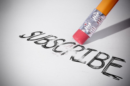 erasing: Pencil erasing the word subscribe on paper