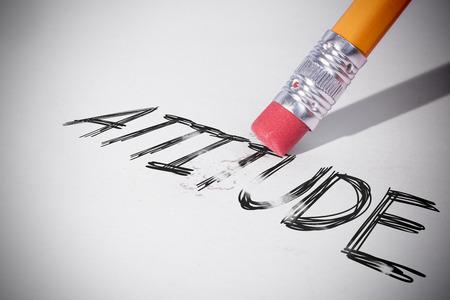 erasing: Pencil erasing the word attitude on paper