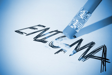 inexplicable: Pencil erasing the word enigma on paper Stock Photo