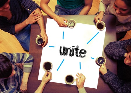 unification: Student drinking coffee sitting around page saying the word unite