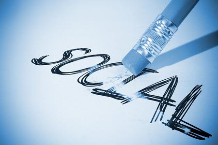 erasing: Pencil erasing the word social on paper
