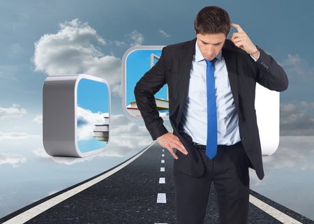Thinking businessman scratching head against road over water reflecting sky