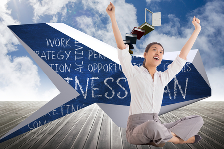 Businesswoman sitting cross legged cheering against book steps leading to door on sky photo