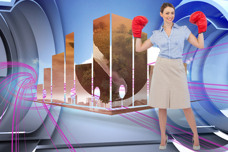 Buisnesswoman posing with boxing gloves against abstract pink design in futuristic structure photo