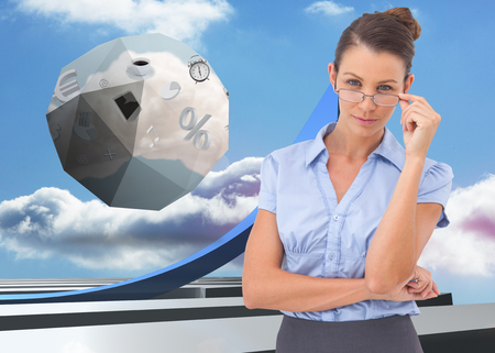 adjusting: Businesswoman adjusting her glasses against blue curved arrow pointing up against sky Stock Photo