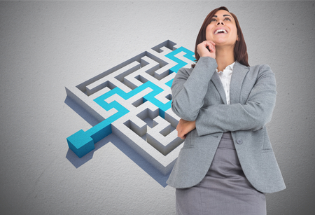 Smiling thoughtful businesswoman against blue arrow solving puzzle Stock Photo - 26808393