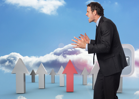 Stressed businessman gesturing against red and grey arrows pointing up against sky photo
