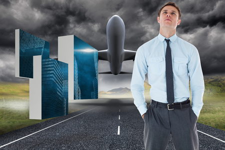 Serious businessman standing with hands in pockets against 3d plane taking off over street photo