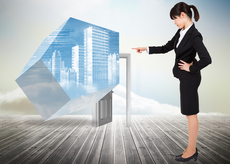 Focused businesswoman pointing against doorway standing on floorboards photo