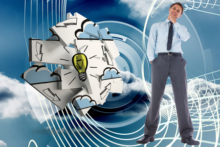Thoughtful businessman with hand on chin against energy design on a futuristic structure photo