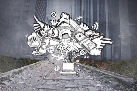 Idee che scorre dal computer portatile di doodle contro la citt� di proiezione sopra sentiero sassoso photo