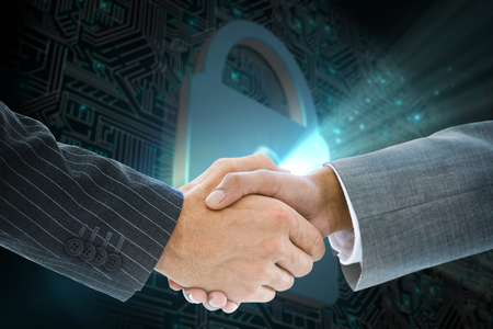 Composite image of business handshake against shiny lock on black background photo