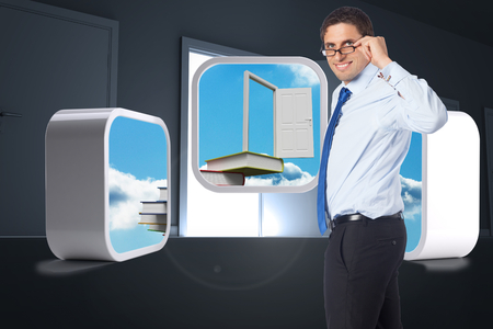 Thinking businessman tilting glasses against door opening revealing light photo