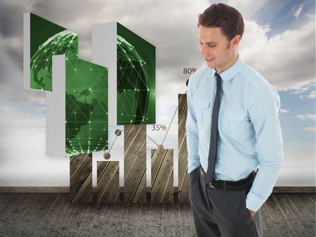 Happy businessman standing with hand in pocket against statistic on sky background photo