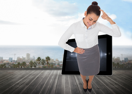 woman looking down: Smiling thoughtful businesswoman against ocean scenic view
