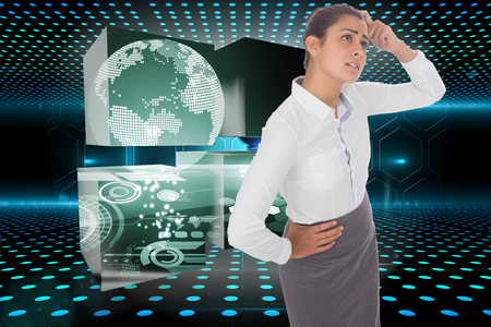 Worried businesswoman against keyhole on technological glowing background photo