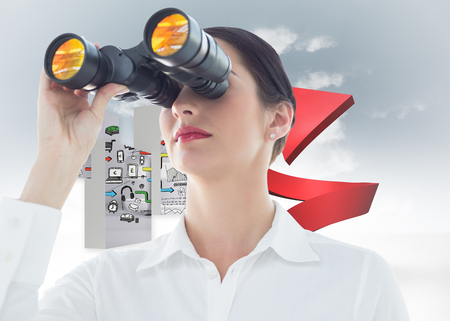 Business woman  looking through binoculars against red spiral arrow in the sky photo