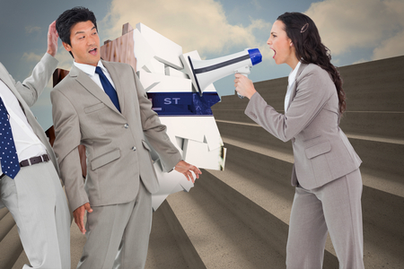 Businesswoman with megaphone yelling at colleagues against steps against blue sky photo
