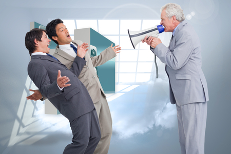 businessman using a megaphone: Senior salesman with megaphone yelling at his employees against room with holographic cloud