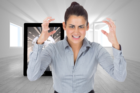 Furious businesswoman gesturing against bright room with opened windows photo