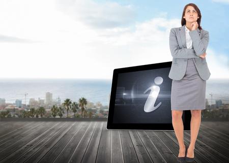 Focused businesswoman against ocean scenic view photo