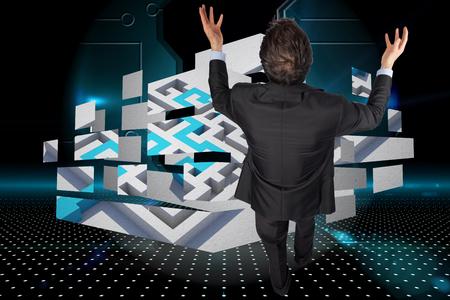Gesturing businessman against doorway on technological black background photo