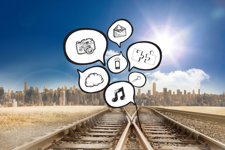 Speech bubbles with app icons against train tracks leading to city under blue sky photo