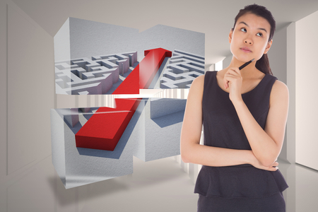 Thinking businesswoman against tiny figures in bright room photo