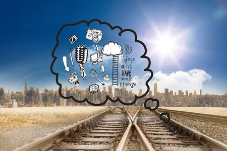 Thought bubbles with doodles against train tracks leading to city under blue sky photo