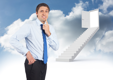 Thinking businessman touching his chin against steps leading to open door in the sky photo