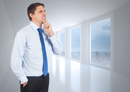 business skeptical: Thinking businessman touching his chin against bright white hall with columns Stock Photo