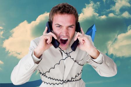 Confident businessman having a phone call against blue arrow pointing up against sky photo