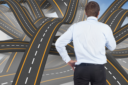 bumpy road: Thinking businessman touching his chin against bumpy road backdrop Stock Photo