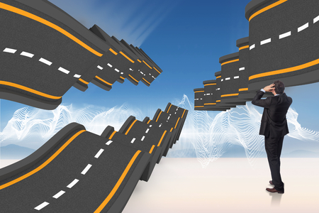 bumpy road: Stressed businessman with hands on head against bumpy road backdrop Stock Photo