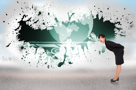 Surprised businesswoman bending against splash showing earth graphic photo