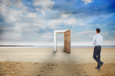 Asian businessman against open door on a beach photo
