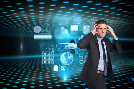 Stressed businessman with hands on head against keyhole on technological glowing background photo