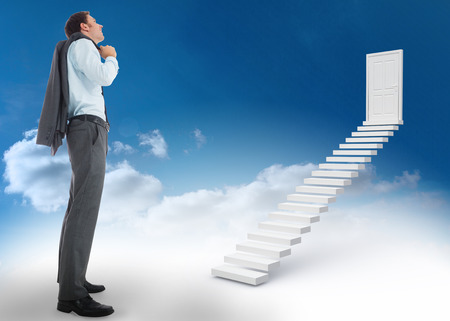 Smiling businessman holding his jacket against steps leading to closed door in the sky photo