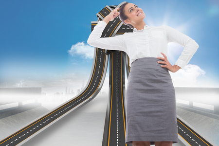 tangled roads: Smiling thoughtful businesswoman against tangled roads in a ball