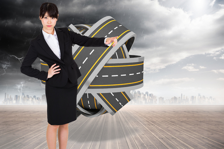 tangled roads: Businesswoman pointing against tangled roads in a ball