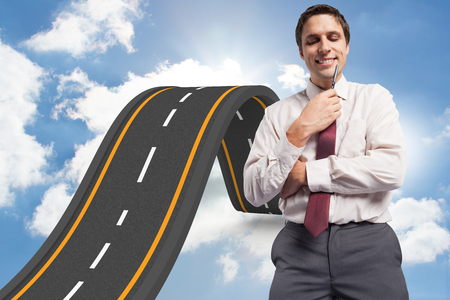 bumpy road: Thoughtful businessman holding pen to chin against bumpy road backdrop Stock Photo