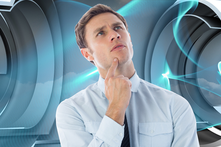 Thinking businessman with finger on chin against abstract blue wave design photo